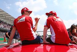 Sebastian Vettel, Ferrari with Kimi Raikkonen, Ferrari on the drivers parade.