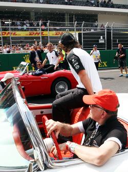 Fernando Alonso, McLaren and team mate Jenson Button, McLaren on the drivers parade.