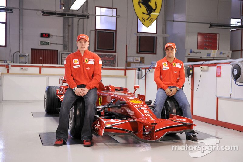 Kimi Raikkonen and Felipe Massa pose with the new Ferrari F2008