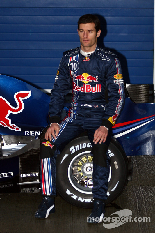 Mark Webber poses with the new Red Bull RB4