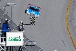 Overall winner Scott Pruett takes the checkered flag