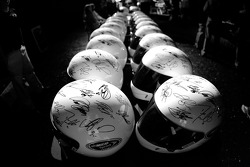 Helmets sign by NASCAR drivers to be given to charities