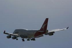 A Qantas Boeing 747-400 flies past