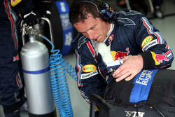 A Red Bull Racing crew member with a tyre