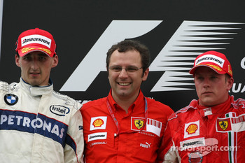Podium: race winner Kimi Raikkonen, second place Robert Kubica, Stefano Domenicali, Scuderia Ferrari, Sporting Director