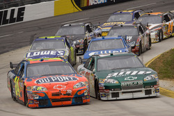 Jeff Gordon and Dale Earnhardt Jr. battle for the lead out of turn four