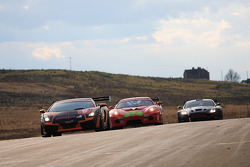 Lamborghini / Ferrari / Aston Martin on start finish straight