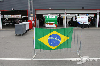 Tony Kanaan shows his country's flag
