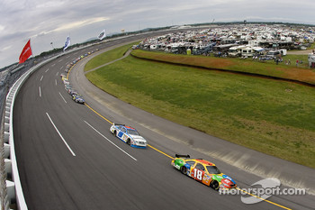 Kyle Busch leads a pack into turn four