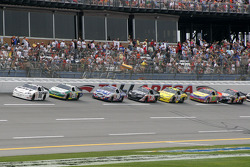 Brad Keselowski leads a group of cars