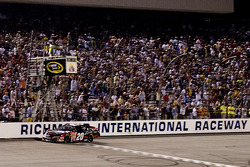 Denny Hamlin takes the checkered flag