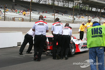 Helio Castroneves is pushed out of line