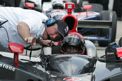 A.J. Foyt IV receives instruction from Brian Barnhart