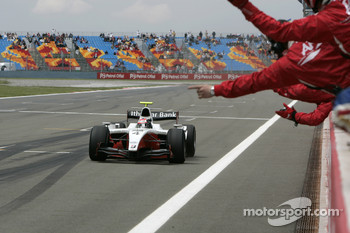 Romain Grosjean crosses the line to take victory