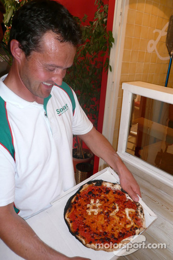 Gianluigi Galli enjoys a pizza
