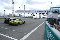 Romain Dumas takes the checkered flag