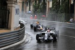 Kazuki Nakajima, Williams F1 Team leads David Coulthard, Red Bull Racing