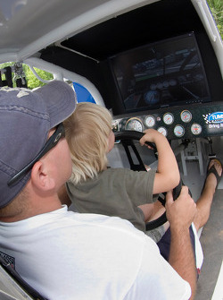 Fans take advantage of the Ganassi Tums racing simulator during The Ganassi Fan Appreciation Day