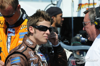 Marco Andretti getting ready for the race and chatting with Johnny Rutherford