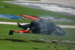 A safety work check on Graham Rahal after he comes to rest in the infield grass
