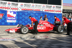 Scott Dixon's car is pushed to Victory Lane