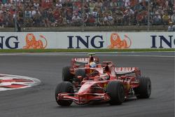 Kimi Raikkonen, Scuderia Ferrari leads Felipe Massa, Scuderia Ferrari