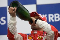 Podium: race winner Felipe Massa celebrates with champagne