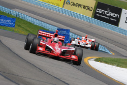 Dan Wheldon leads Helio Castroneves