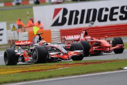 Heikki Kovalainen, McLaren Mercedes, MP4-23 and Kimi Raikkonen, Scuderia Ferrari, F2008