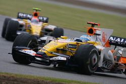 Fernando Alonso, Renault F1 Team, R28 and Nelson A. Piquet, Renault F1 Team, R28