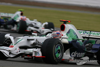 Jenson Button, Honda Racing F1 Team, RA108 leads Rubens Barrichello, Honda Racing F1 Team, RA108