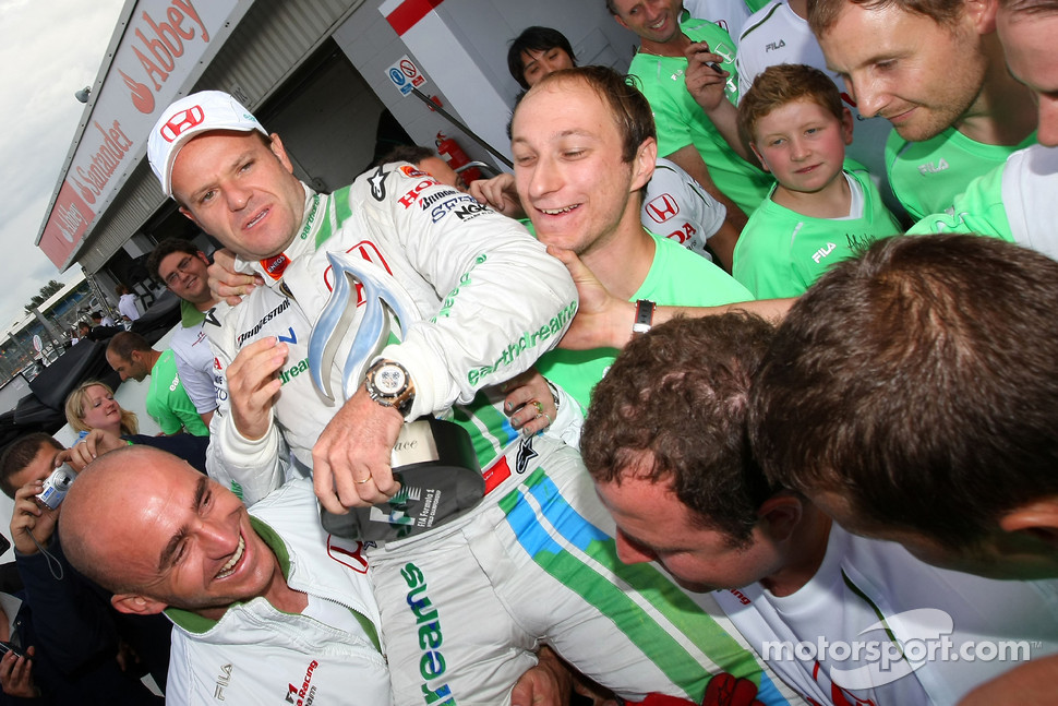 Rubens Barrichello celebrates third place finish