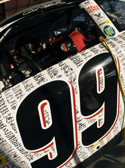 The Office Depot Ford has a special paint scheme with autographs of their employees from around the world