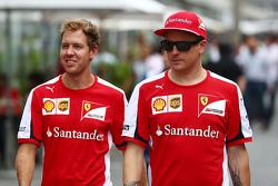 (L to R): Sebastian Vettel, Ferrari with team mate Kimi Raikkonen, Ferrari