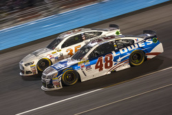 Jimmie Johnson, Hendrick Motorsports Chevrolet and Cole Whitt, Front Row Motorsports Ford