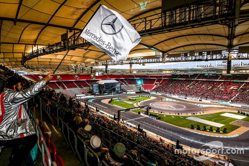 Fan waves the Mercedes flag