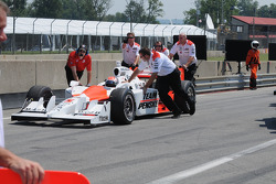 Ryan Briscoe being pushed back to the pits