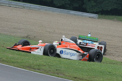 Enrique Bernoldi and Ryan Hunter-Reay slide to a stop in the grass