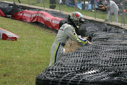 Logan Gomez climbs through the tires to exit the track
