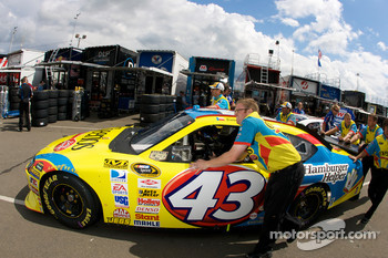 Cheerios Dodge crew members push the #43 car to the garage