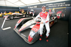 Rinaldo Capello poses with an Audi Sport Team Joest Audi R10 TDI on display