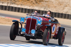 Actor Patrick Dempsey gets a ride in a historic race car