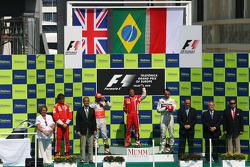 Podium: race winner Felipe Massa, second place Lewis Hamilton, and third place Robert Kubica