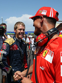 Michael Schumacher, Test Driver, Scuderia Ferrari and Sebastian Vettel, Scuderia Toro Rosso
