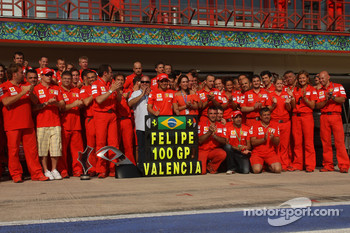 Race winner Felipe Massa celebrates with Kimi Raikkonen and Scuderia Ferrari team members
