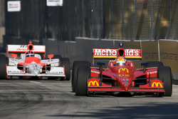 Justin Wilson leads Helio Castroneves