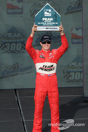Ryan Briscoe raises his Pole Award in triumph