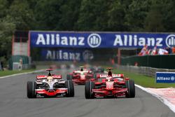 Kimi Raikkonen, Scuderia Ferrari overtakes Lewis Hamilton, McLaren Mercedes