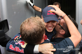 Pole winner Sebastian Vettel celebrates with his team