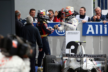 Race winner Sebastian Vettel celebrates with Robert Kubica